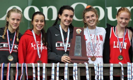 Leon's girls cross team celebrated a District 1-3A cross country meet at Apalachee Regional Park on Oct. 24, 2019. From left: Stella Lewis, Lily Moore, Avery Calabro, Lilli Unger, Mallory Robinson.