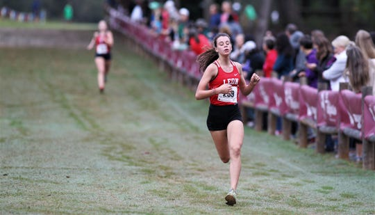 Leon freshman Lily Moore finishes the District 1-3A cross country meet at Apalachee Regional Park on Oct. 24, 2019.