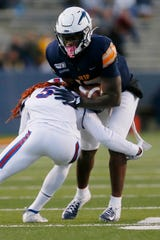 UTEP's Justin Garrett runs the ball during the game against Louisiana Tech Saturday, Oct. 26, at the Sun Bowl in El Paso.