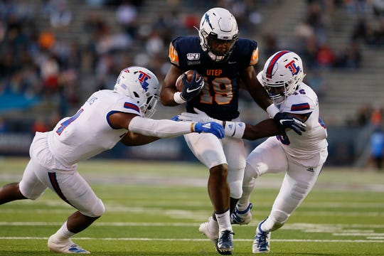 UTEP's Treyvon Hughes goes against Louisiana Tech defense during the game Saturday, Oct. 26, at the Sun Bowl in El Paso.
