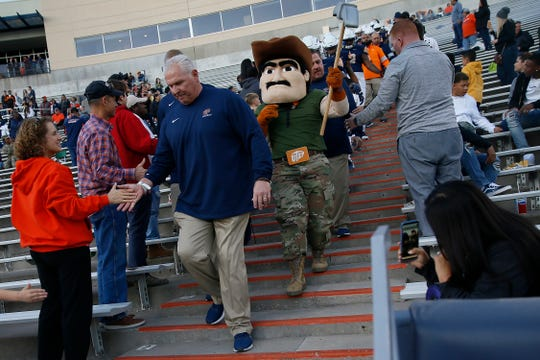UTEP head coach Dana Dimel leads the team out of the Mine Shaft for the game against Louisiana Tech Saturday, Oct. 26, at the Sun Bowl in El Paso.