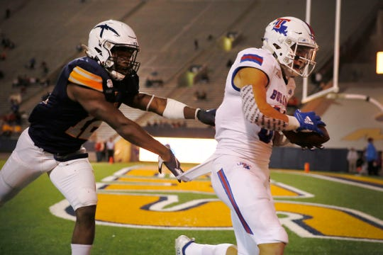 UTEP's Adrian Hynson attempts to tackle Louisiana Tech's Griffin Hebert as he scores a touchdown during the game Saturday, Oct. 26, at the Sun Bowl in El Paso.