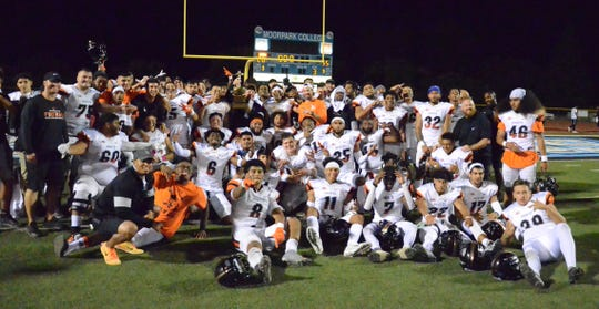 The Ventura College football team celebrates winning the 52nd Citrus Cup game at Griffin Stadium on Saturday night. VC beat rival Moorpark College, 55-20.