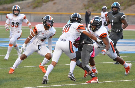 Ventura College linebackers Jalen Cooper (10) and Jeremiah Nunnery (4), shown making a tackle against Moorpark College, both made plays on the goal line as the Pirates defense protected a late lead in Long Beach on Saturday night.