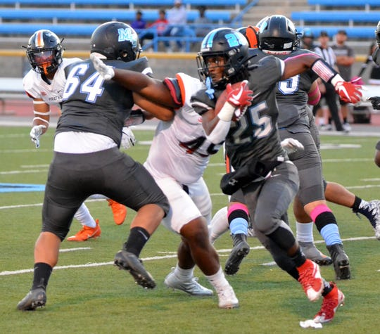Moorpark College running back Brandon Archibald looks for daylight against Ventura College in the 52nd Citrus Cup game on Saturday night at Griffin Stadium. VC won 55-20.