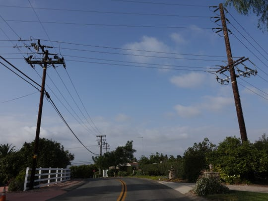Power lines crisscross on Cerro Crest Drive in Camarillo, one of many local areas where power shutoffs are being considered as Santa Ana winds arrive in Ventura County.