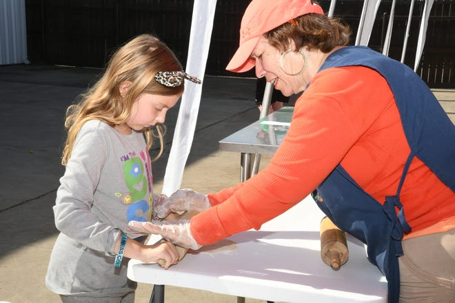 Ember Munson, 8, learns how to make homemade tortillas at FoodLink's Food Day celebration on Oct. 26, 2019.
