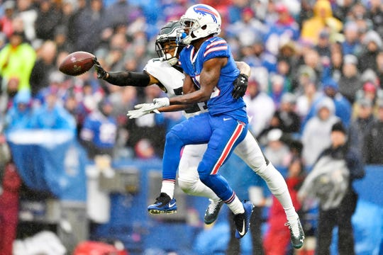 Philadelphia Eagles' Ronald Darby, left, blocks a pass intended for Buffalo Bills' John Brown during the second half of an NFL football game, Sunday, Oct. 27, 2019, in Orchard Park, N.Y.