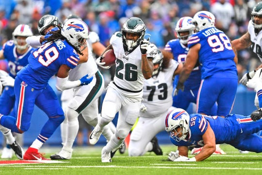 Philadelphia Eagles' Miles Sanders (26), center, breaks through the Buffalo Bills defense to score a touchdown during the second half of an NFL football game, Sunday, Oct. 27, 2019, in Orchard Park, N.Y.