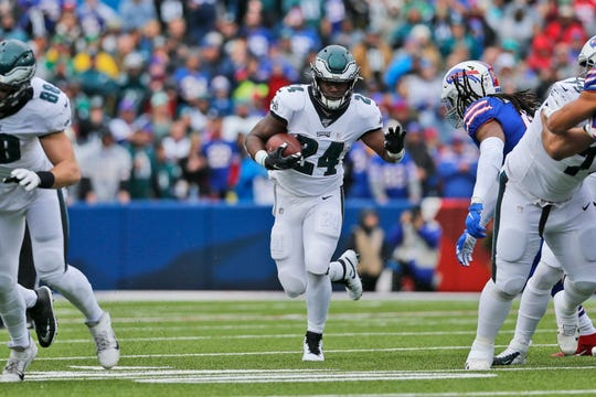 Philadelphia Eagles' Jordan Howard runs the ball during the first half of an NFL football game against the Buffalo Bills, Sunday, Oct. 27, 2019, in Orchard Park, N.Y.