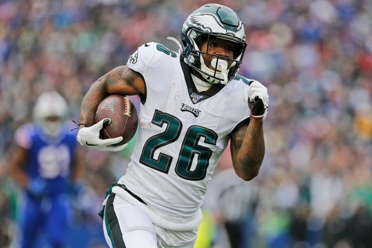 Philadelphia Eagles' Miles Sanders runs the ball during the first half of an NFL football game against the Buffalo Bills, Sunday, Oct. 27, 2019, in Orchard Park, N.Y.