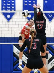 Sheridan sophomore Ally Perkins spikes the ball past Danae Pickens during the Generals' four-set win against Fairfield Union in a Division II district final at Chillicothe Southeastern.