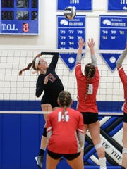 Braidyn Reed spikes the ball for Fairfield Union during a four-set loss to Sheridan on Saturday in a Division II district final at Chillicothe Southeastern.