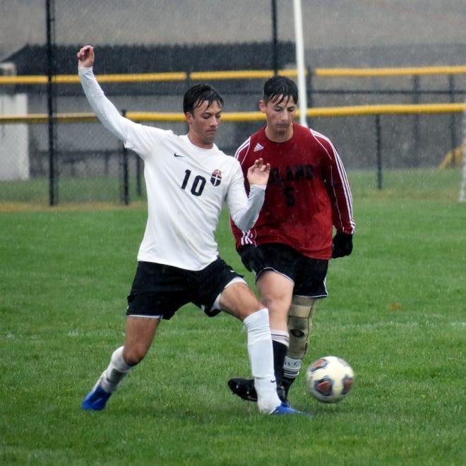 Rosecrans' Josh Merva battles for possession against Hiland's Casey Low in Saturday's Division III boys soccer district final. Hiland won 5-2.