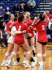Sheridan's Brooklyn Heller, left, Julia Finck, Grace Dowdell, Erin Schultz, Ally Perkins and Grace Conrad celebrate on the floor after clinching a four-set win against Fairfield Union on Saturday in a Division II district final at Chillicothe Southeastern.