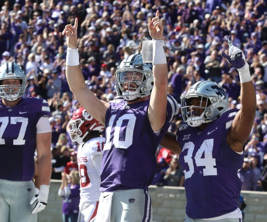Kansas State Wildcats quarterback Skylar Thompson (10) and running back James Gilbert (34) celebrate a touchdown in the third quarter against the Oklahoma Sooners.