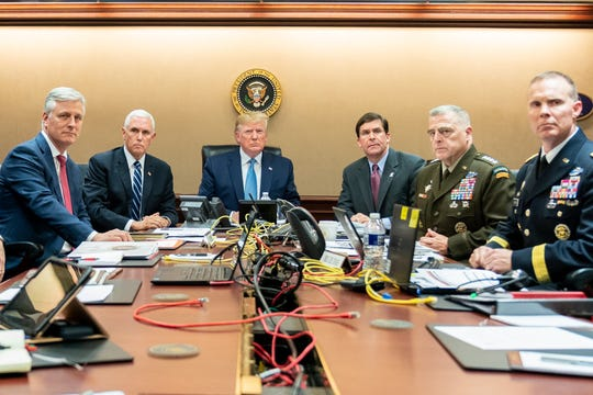 The White House released photos of President Donald Trump watching from the Situation Room as ISIS leader Abu Bakr al-Baghdadi was killed in a U.S. raid.