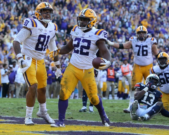 LSU running back Clyde Edwards-Helaire celebrates a touchdown run during the third quarter against Auburn.
