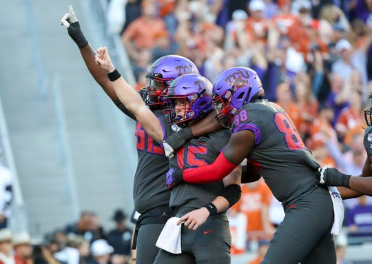 TCU Horned Frogs quarterback Max Duggan (15) celebrates with teammates after scoring a touchdown during the fourth quarter against the Texas Longhorns at Amon G. Carter Stadium.