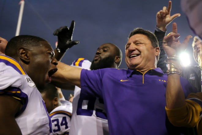 LSU Tigers head coach Ed Orgeron celebrates the win over the Auburn Tigers with his players.