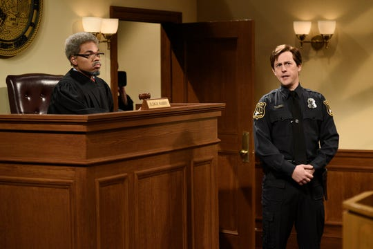 "Chance the Rapper, left, plays a TV court show judge and Alex Moffat plays a bailiff during a sketch from this weekend's ""Saturday Night,"" which was hosted by Chance."