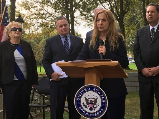 Marlboro's Jodie Dashore, a chronic Lyme disease survivor and a practitioner who treats others with the condition, speaks at Friday's press conference in Wall. At left are Wall resident Pat Smith, president of the Lyme Disease Association (far left) and Rep. Chris Smith (second from left).