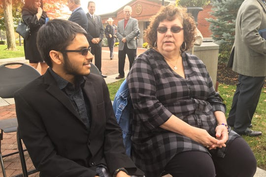 Marlboro's Brian Dashore (left) and Jackson's Deborah Scatuccio, both chronic sufferers of tick-borne illness, attend Friday's press conference in Wall.