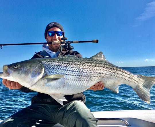 Jerry Malanga, Point Pleasant, with a 49-inch striped bass he caught jigging off of Asbury Park Oct. 23.