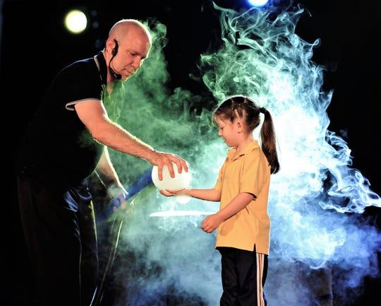 Jeff Boyer presents his bubble magic in Abilene on Sunday.