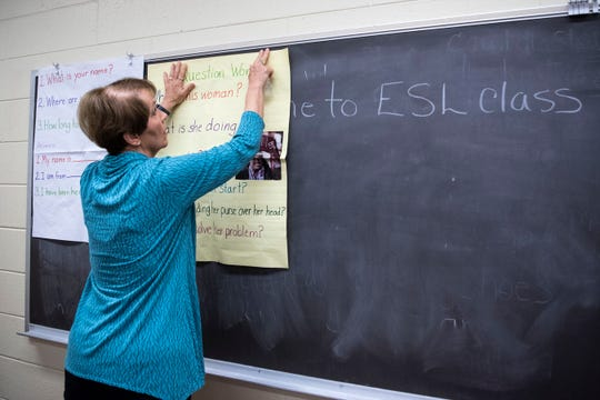 Laurel Macon, a volunteer English second language teacher, prepares for class on Monday, Oct. 28, 2019 at the Calhoun County jail in Battle Creek, Mich.