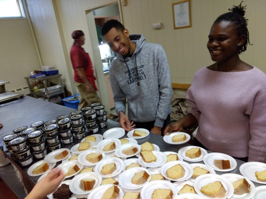 Zitouni Layachi and Serina Elliott, right, serve slices of cake for dessert at the weekly dinner held at First Presbyterian Church of Johnson City. The dinner is one of several outreach activities the church does as part of its This Day program.