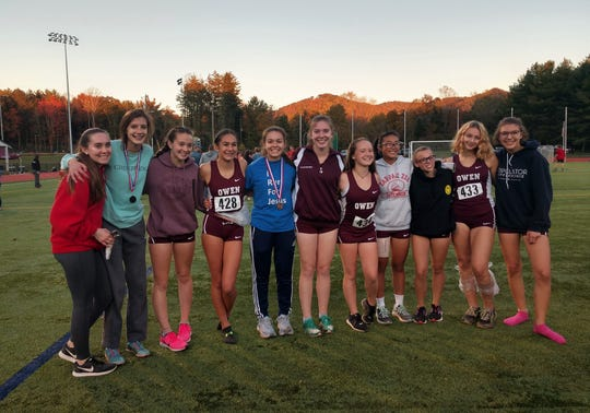 The Owen Warlassies cross country team celebrates its third straight Western Highlands Conference championship, Oct. 24, as five Owen runners finished in the top 10.