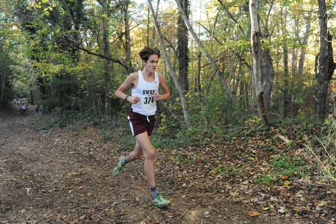 Owen junior Noah Lehman leads the way, Oct. 24, as the Warhorses won their second consecutive conference championship in cross country. Lehman, who finished first with a time of 17:18.8, was one of seven Warhorses to finish in the top 10.