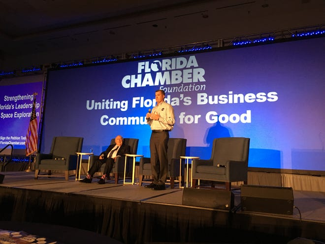 """Mark Wiese, manager of NASA's Gateway logistics program, speaks at Florida Chamber of Commerce's """"Future Forum"""" in Orlando."""