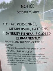 Sign posted in front of main door at Synergy Fitness in Williston. Members were alerted to the closing on Friday, Oct. 25.