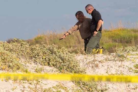 Several state agencies conduct an investigation on Padre Island beach in Kleberg County near mile marker 263 after human remains where found on Monday, Oct. 28, 2019.