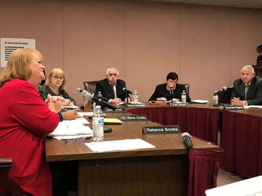 Members of the Mount Healthy Board of Education met on Oct. 21, 2019 in what became a contentious meeting that included accusations of misspending.