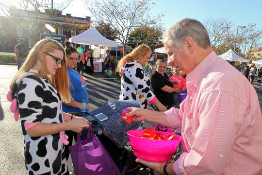 Mayor Joe Pitts passes out treats at Clarksville's annual Fright on Franklin on Sunday, Oct. 27, 2019.