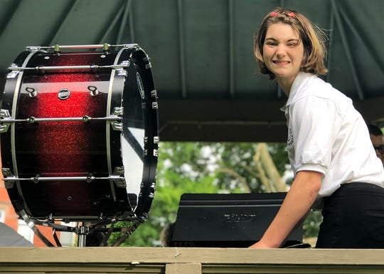 Lacey Richcreek, a senior at Coshocton High School, participated in the Coshocton County Community Band. She did her part in setting up the instruments prior to a concert in the park earlier this summer.