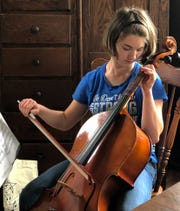 Playing the cello is just one way that Coshocton High School Senior, Lacey Richcreek, stays strong in her life with cerebral palsy.