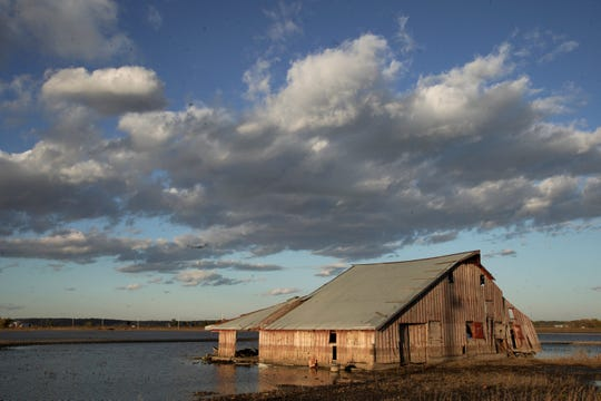 A barn sits in floodwaters in Pacific Junction on Oct. 22, 2019. Flooding along the Missouri River stretched into the fall due to a still-high river, saturated ground and broken levees.