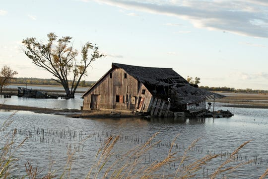 A barn sits in floodwaters in Pacific Junction, Iowa, on Tuesday, Oct. 22, 2019. Flooding along the Missouri River has stretched on for seven months in places and could endure through the winter, leaving some Upper Midwest farmland and possibly some homes encased in ice. The icy flooding is possible due to a still-high river, saturated ground, broken levees and a forecast for a wetter-than-normal winter.
