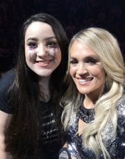 """L-R:  Fan Mary Morgan (18) and Carrie Underwood after the performance of """"The Champion"""" at the """"Cry Pretty"""" tour stop in Des Moines."""