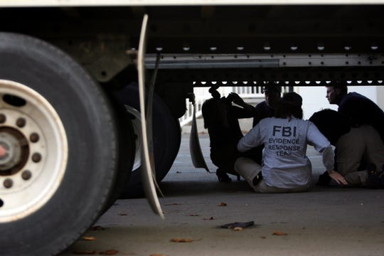 Members of the F.B.I. Response Team collect evidence underneath a Semi Truck at a warehouse at 5151-5171 Miller Road in Dearborn, Mich., where an F.B.I. raid was conducted on Wednesday, Oct. 28, 2009.  Imam Luqman Ameen Abdullah, imam of the Masjid Al-Haqq mosque in Detroit. The FBI says Luqman Ameen Abdullah was fatally shot Wednesday, Oct. 28, 2009,  after resisting arrest and firing at agents at a warehouse in Dearborn. KIMBERLY P. MITCHELL/Detroit Free Press