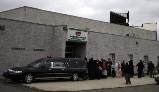 Mourners attend the funeral service for of Luqman Ameen Abdullah, 53, leader of the Masjid Al-Haqq mosque in Detroit, on Saturday, October 31, 2009, in Detroit at the Muslim Center.