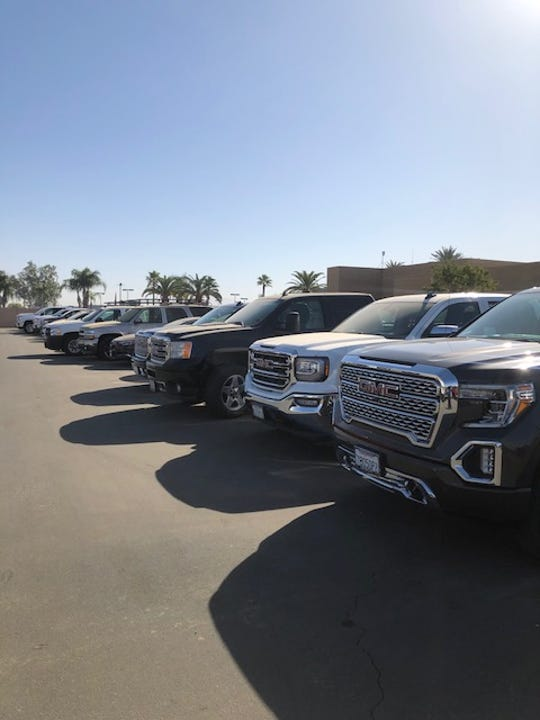 At Motor City Buick GMC in Bakersfield, California, 55 vehicles sit on the lot awaiting parts for repairs.