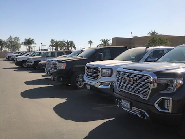 AtMotor City Buick GMC inBakersfield, California, 55 vehicles sit on the lot awaiting parts for repairs.