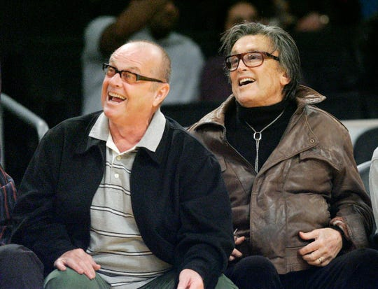 This March 27, 2007 file photo shows producer Robert Evans, right, and actor Jack Nicholson at a basketball game between Memphis Grizzlies' and Los Angeles Lakers at the Staples Center in Los Angeles.