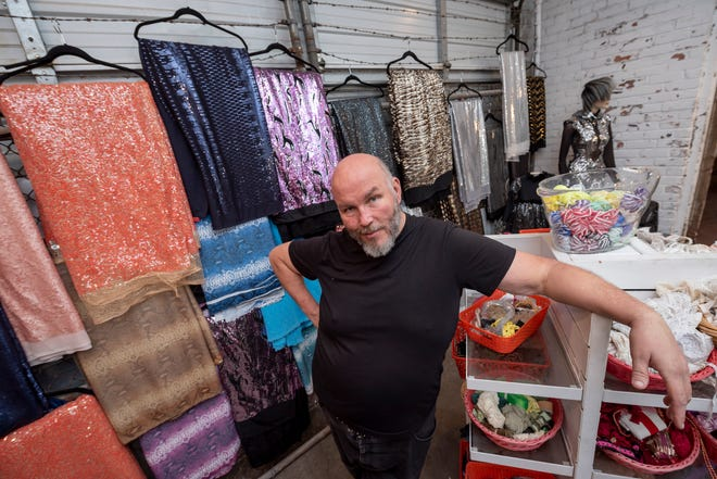 Benson Roberts III stands in the showroom of the Detroit Fabric Company in Detroit.