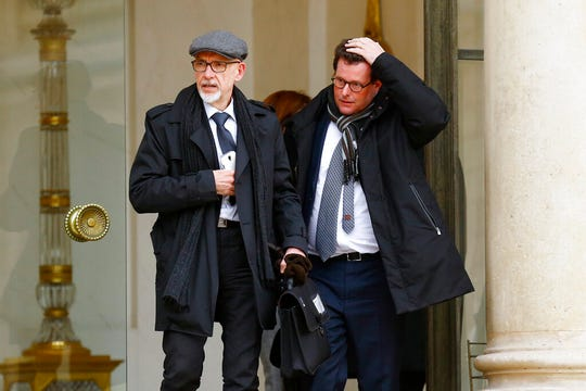 """In this March 21, 2016, file photo, Georges Salines, left, whose daughter was killed in the 2015 Paris attacks by Islamic militants, and family victims' lawyer Jean Reinhart leave the Elysee Palace in Paris, after a meeting with French President Francois Hollande and other officials. Salines said the Oct. 26, 2019, death of Islamic State leader Abu Bakr al-Baghdadi, who inspired the attacks, brought a welcome """"sense of satisfaction."""""""